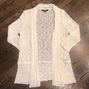 Size medium cream colored light weight cardigan.